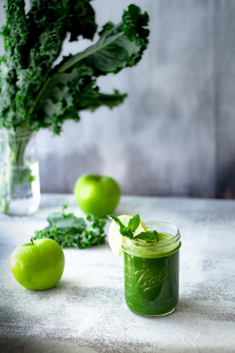 green apple fruit in clear glass cup
