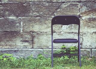black metal chair on green grass