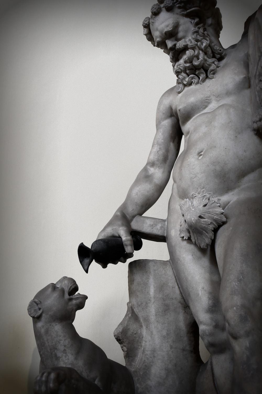 man holding black steel pipe statue