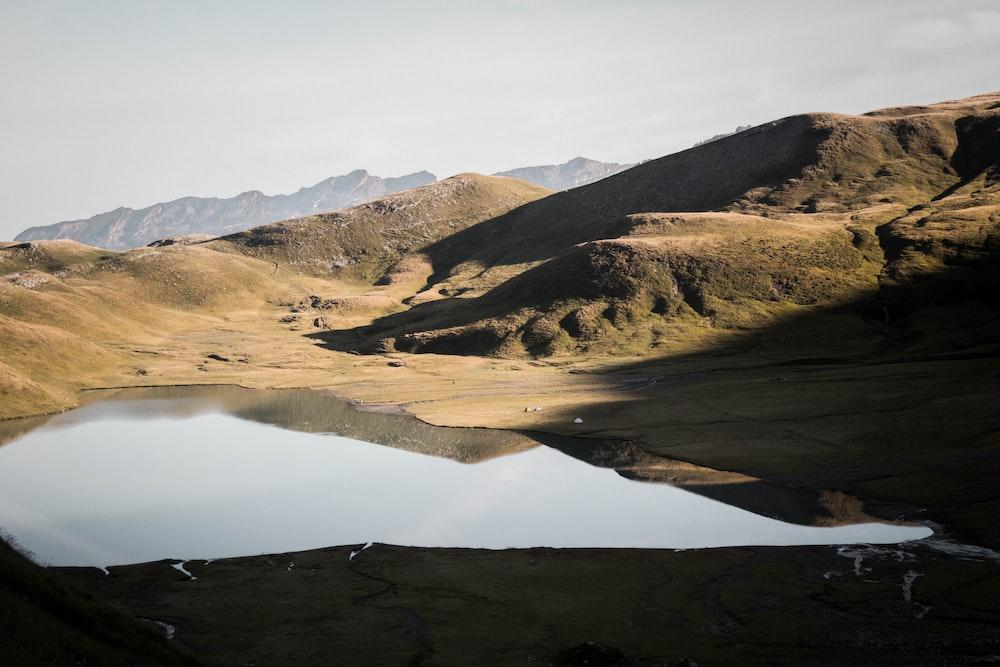 brown mountains near lake during daytime