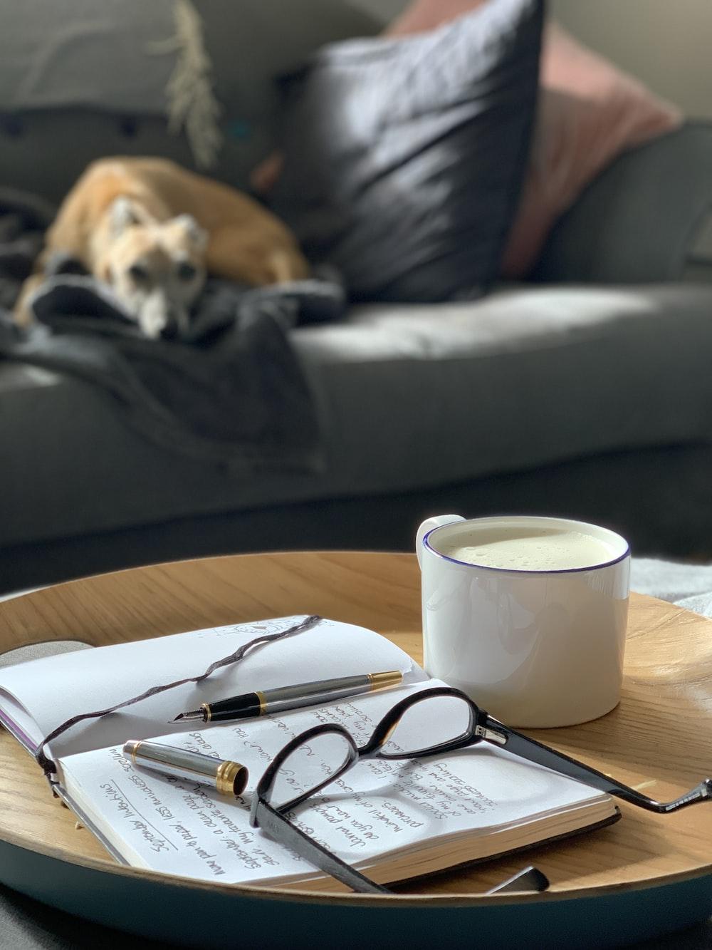 black framed eyeglasses on white notebook