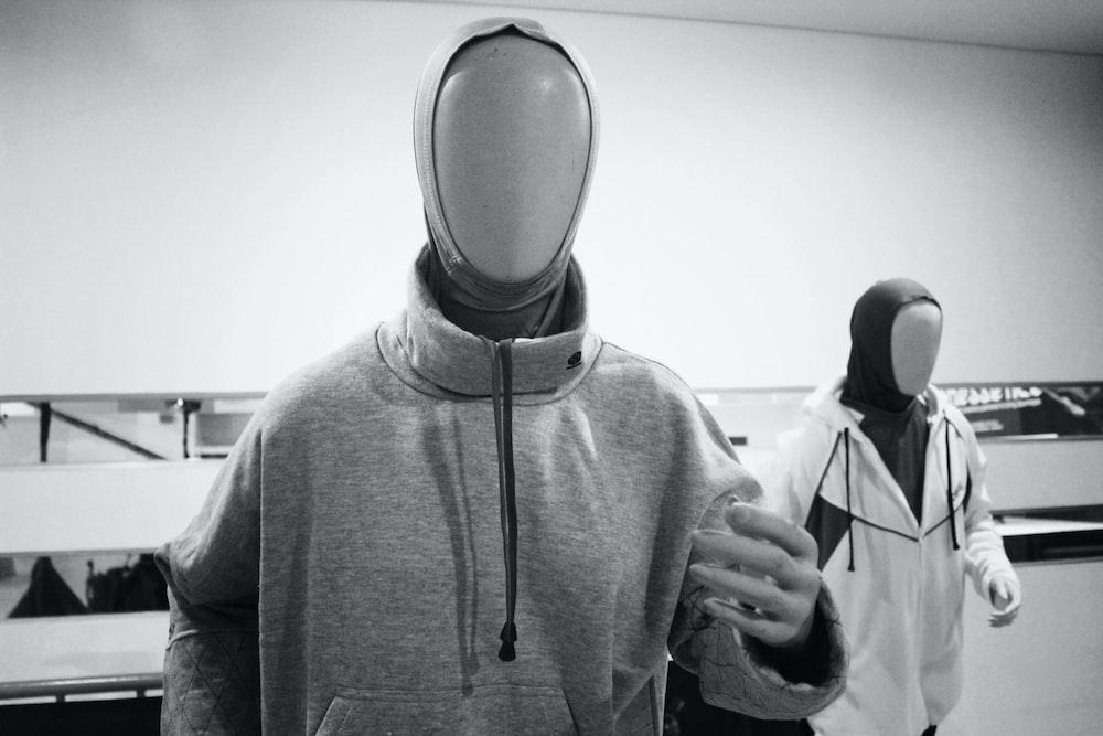 man in gray hoodie wearing black headphones
