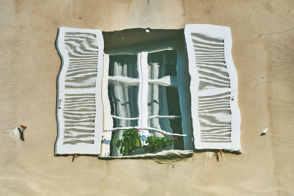 white and green wooden window frame
