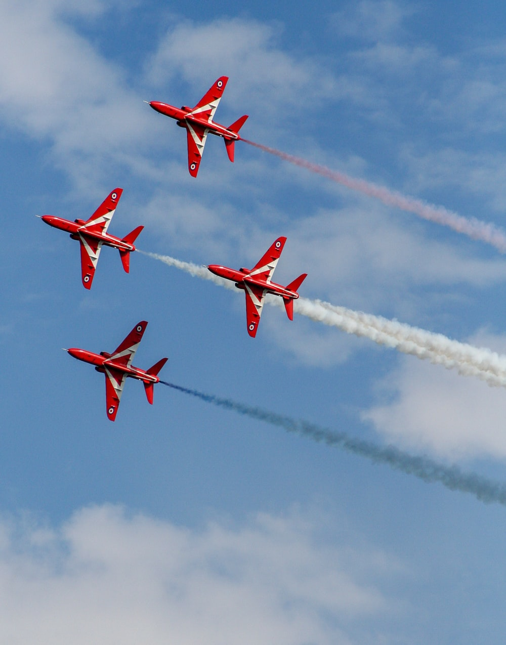 red fighter plane in the sky