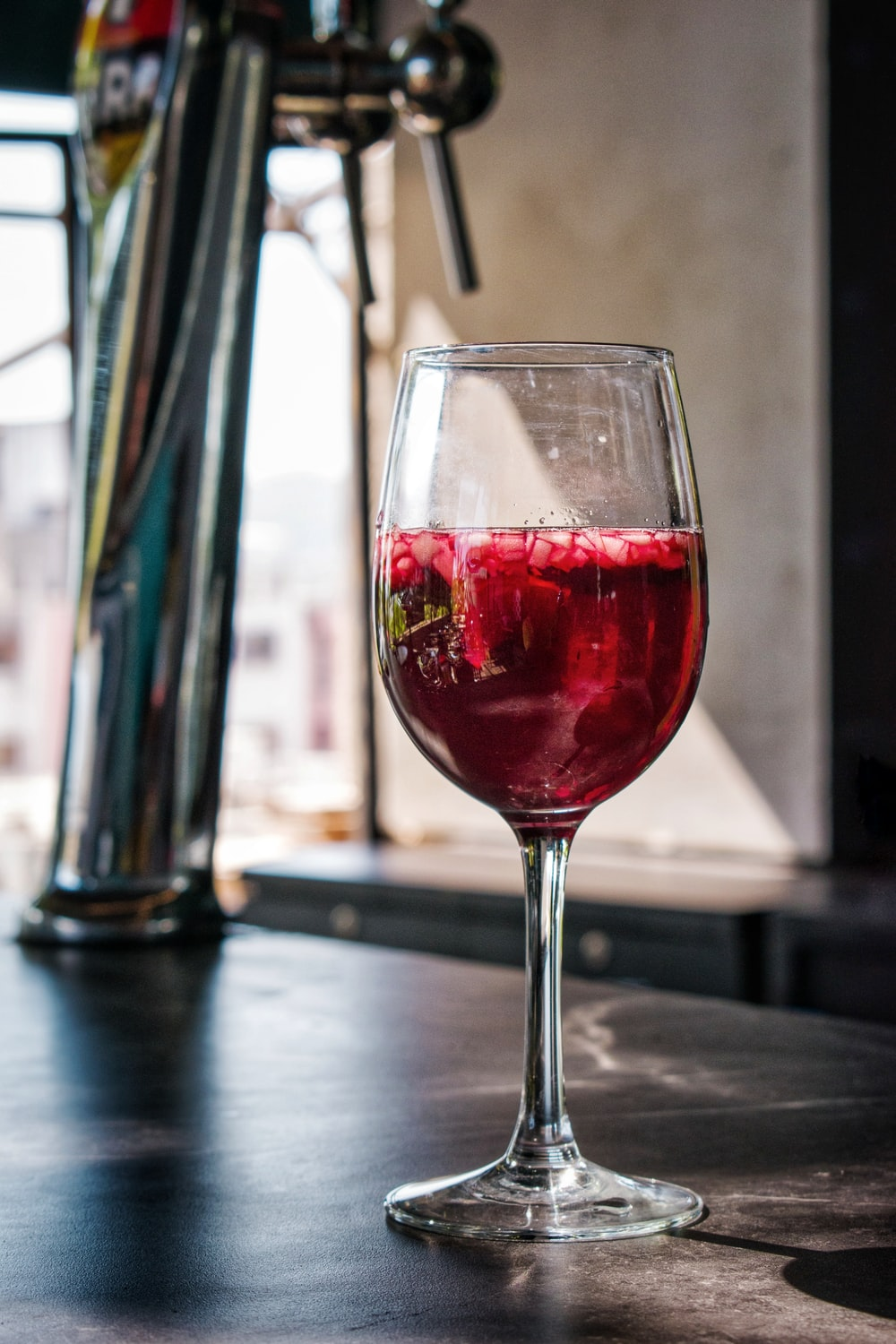 red wine in clear wine glass on table