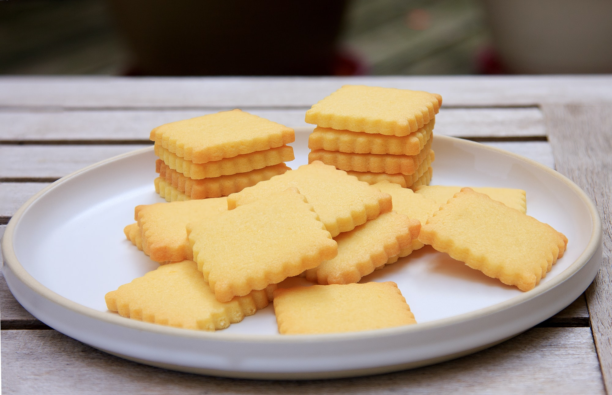 homemade shortbread cookies on a plate on a wooden table