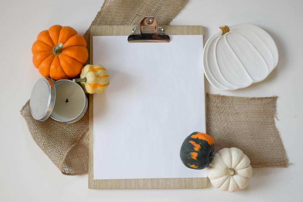 orange and white pumpkins on white table