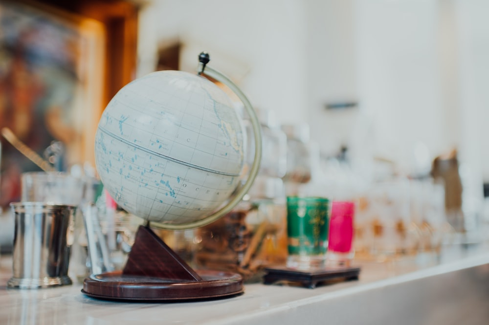 white and blue desk globe on white table