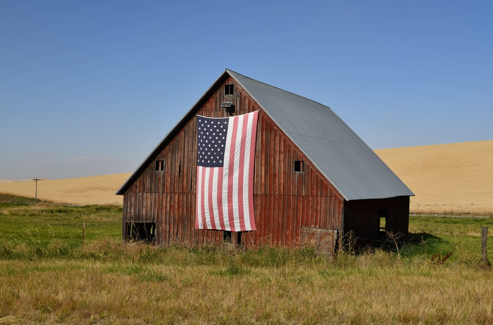red and white barn house under blue sky during daytime