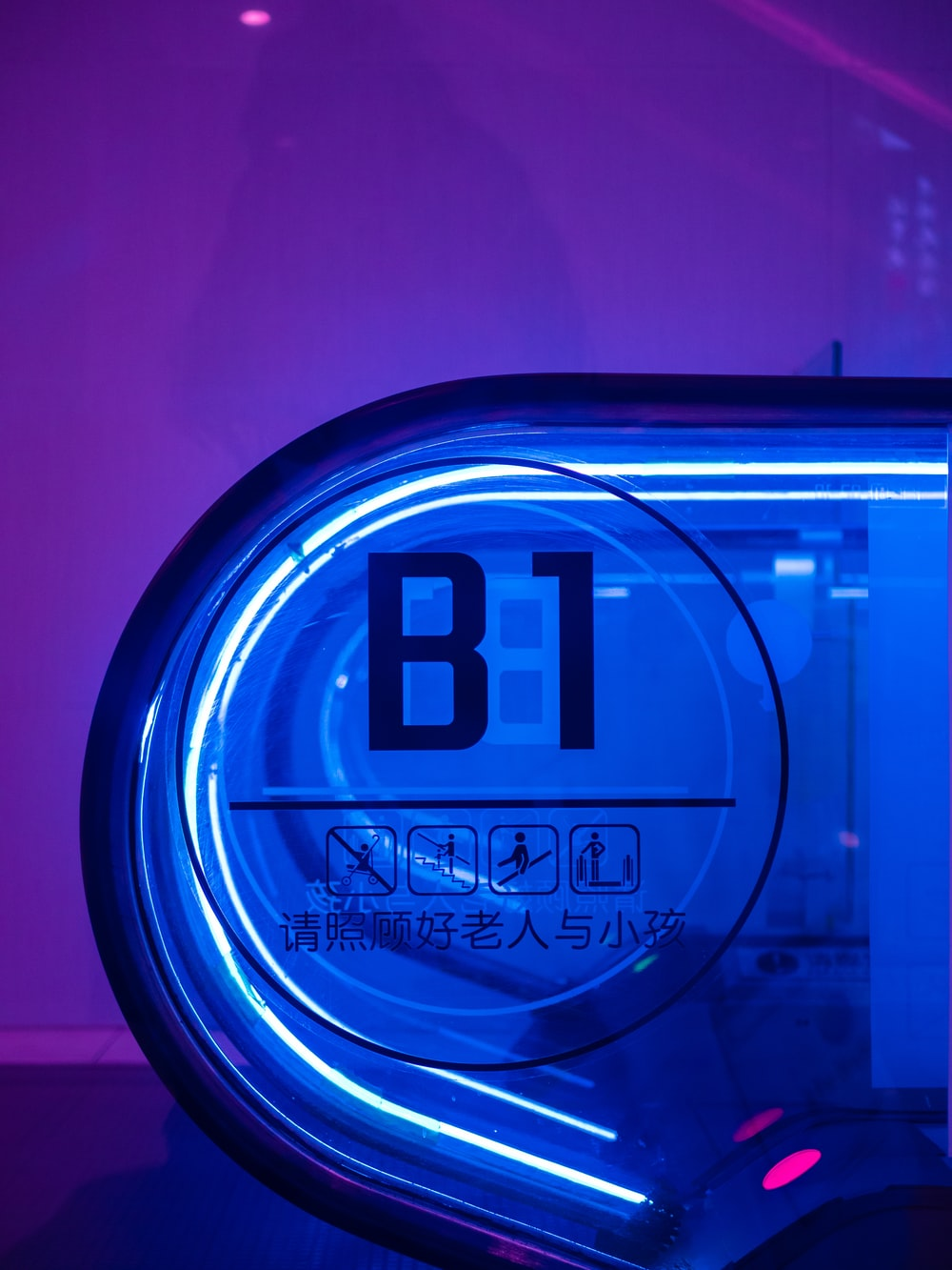 blue and white round digital clock at 12 00