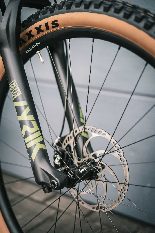black and yellow bicycle wheel