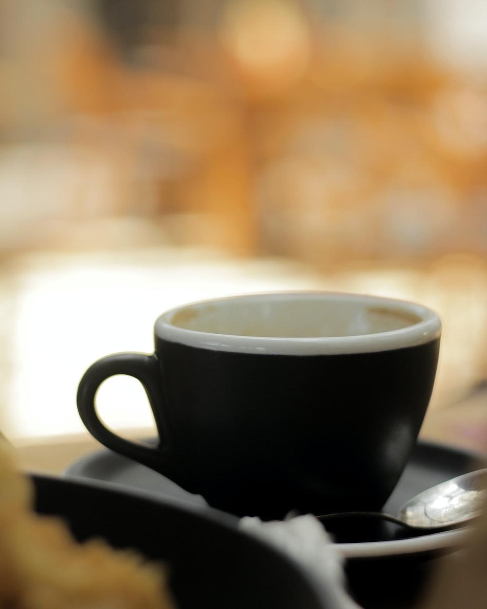 black ceramic mug on saucer