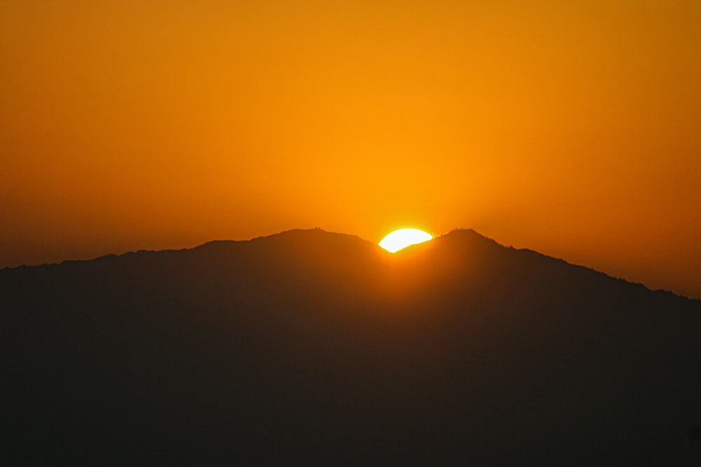 sun setting over the mountains