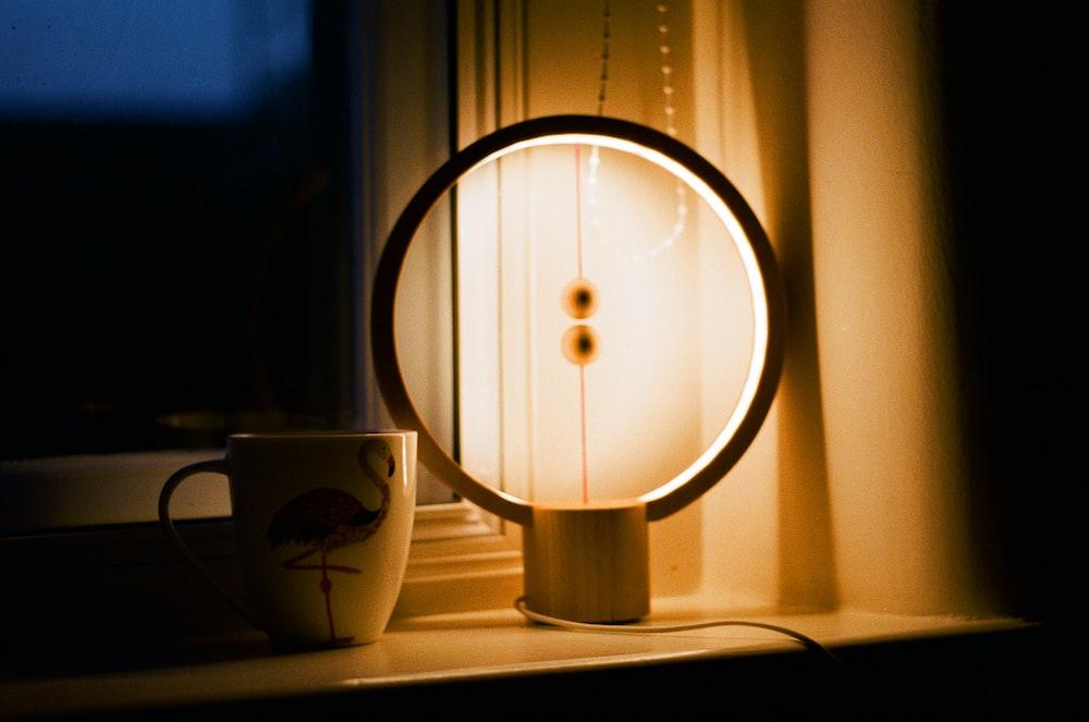 white and brown round lamp