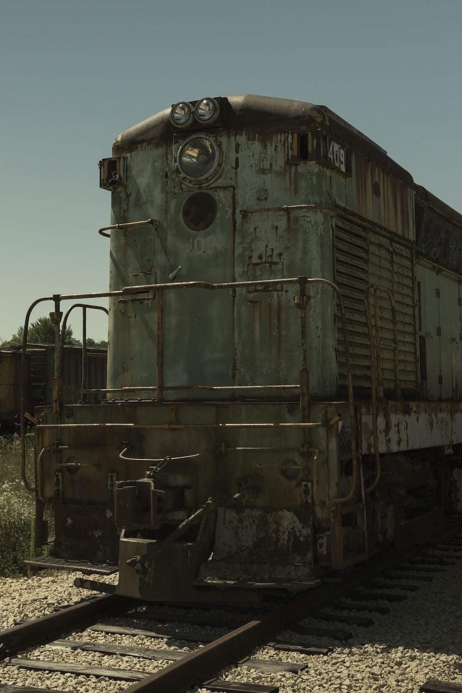 brown train on rail tracks during daytime