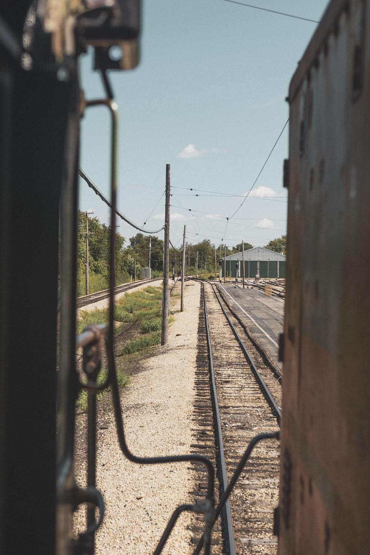 train rail near body of water during daytime