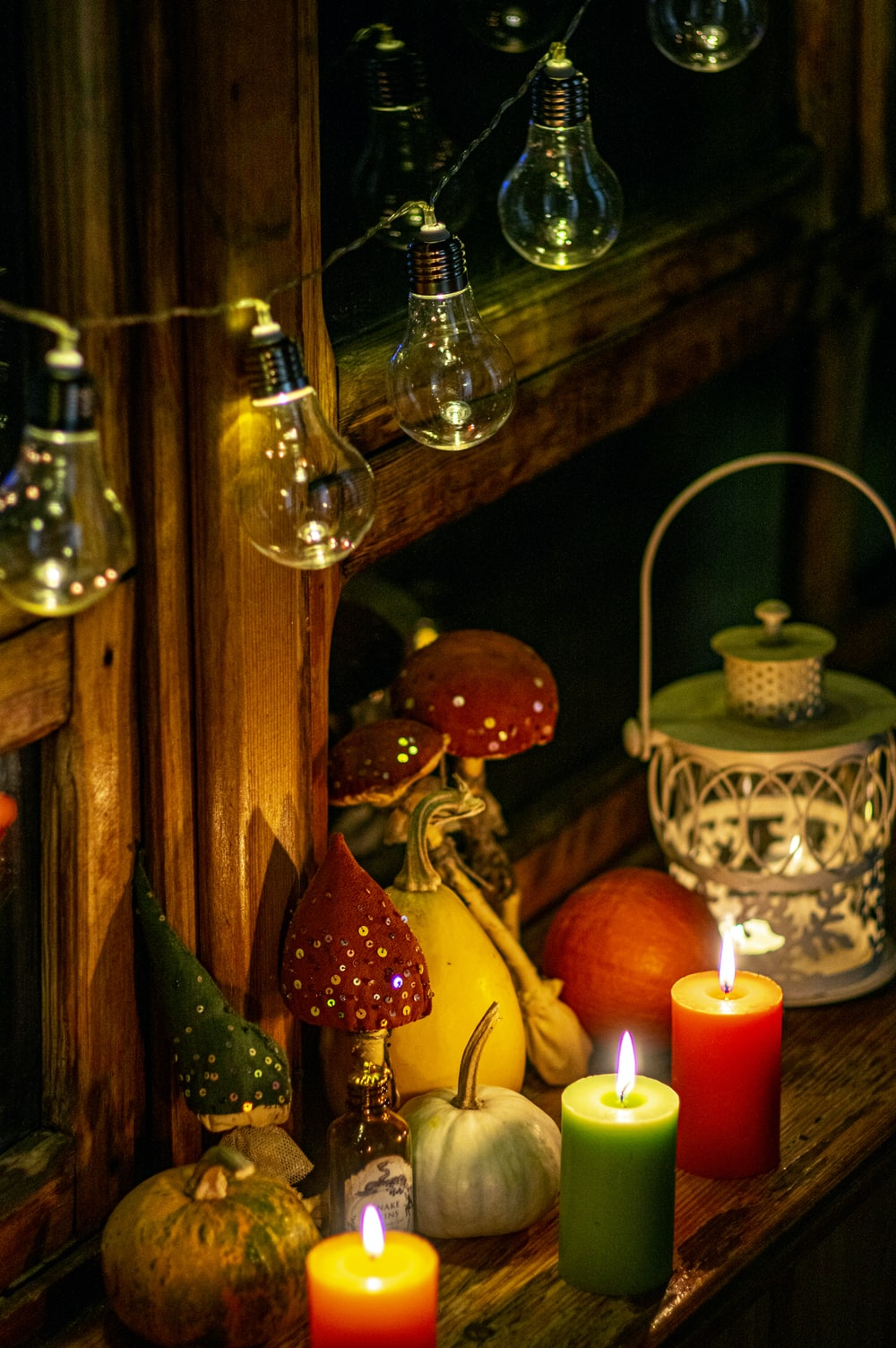 lighted candles on brown wooden candle holder
