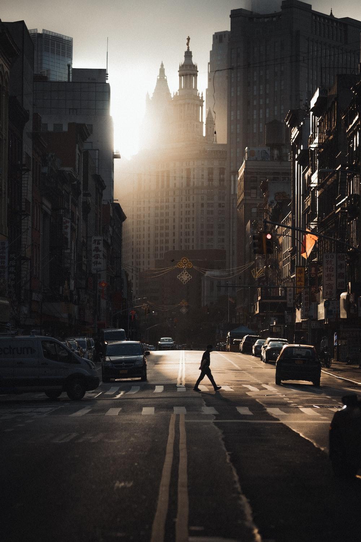 people walking on pedestrian lane in between high rise buildings during daytime