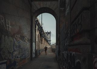 gray concrete hallway with graffiti