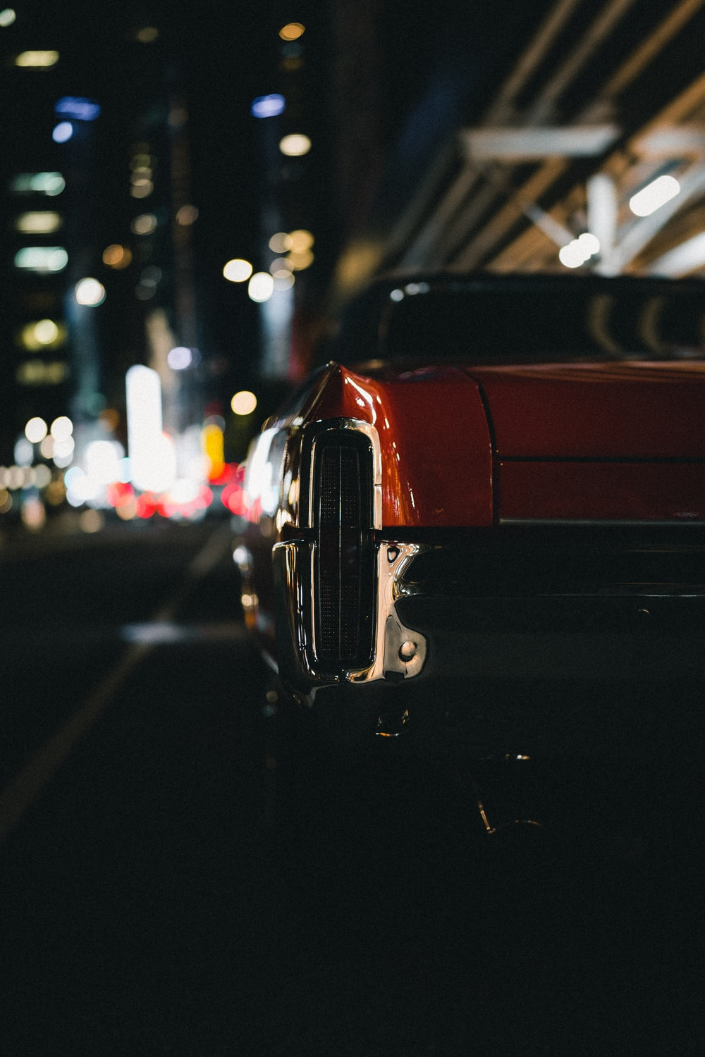 red car on the road during night time