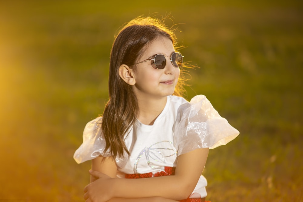 woman in white shirt wearing sunglasses