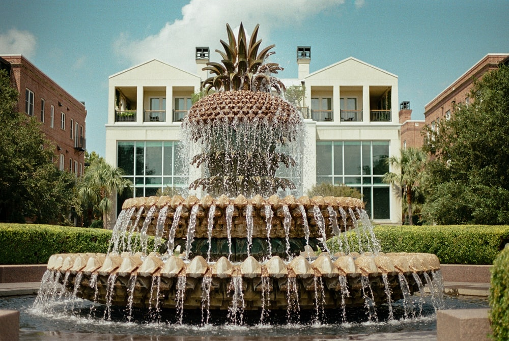 water fountain in front of white building