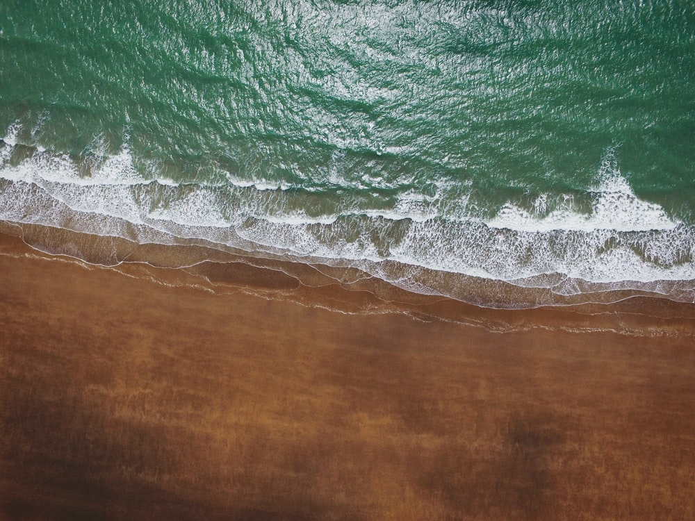 green water waves on brown wooden table