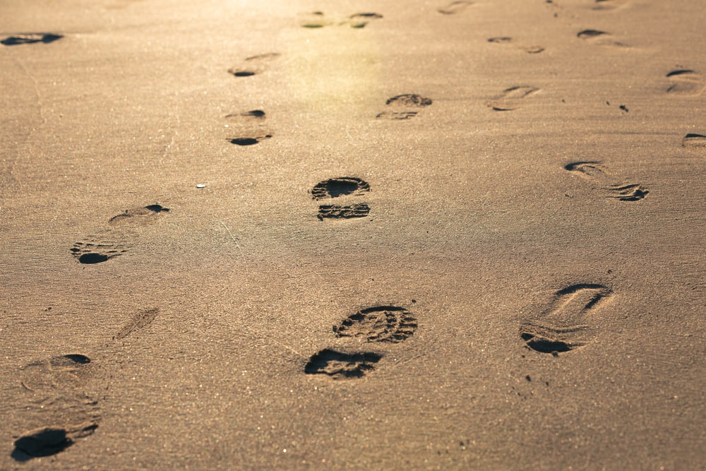 foot prints on brown sand