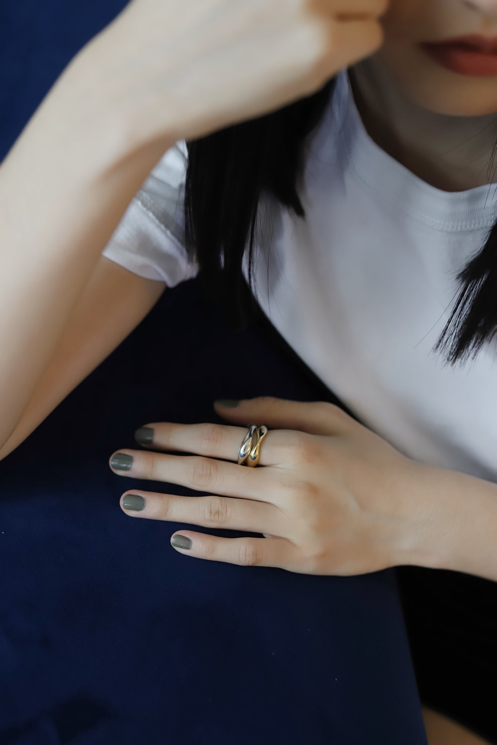 woman in white v neck shirt wearing gold ring