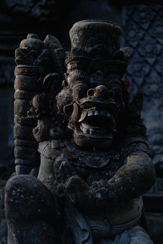 black concrete human face statue