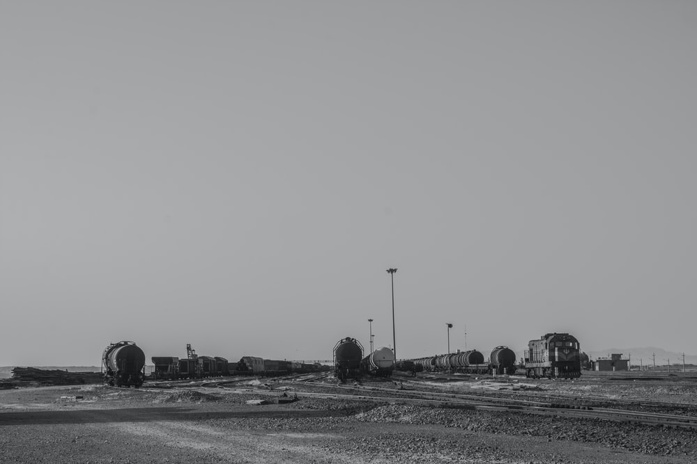 grayscale photo of a city with a river in the distance