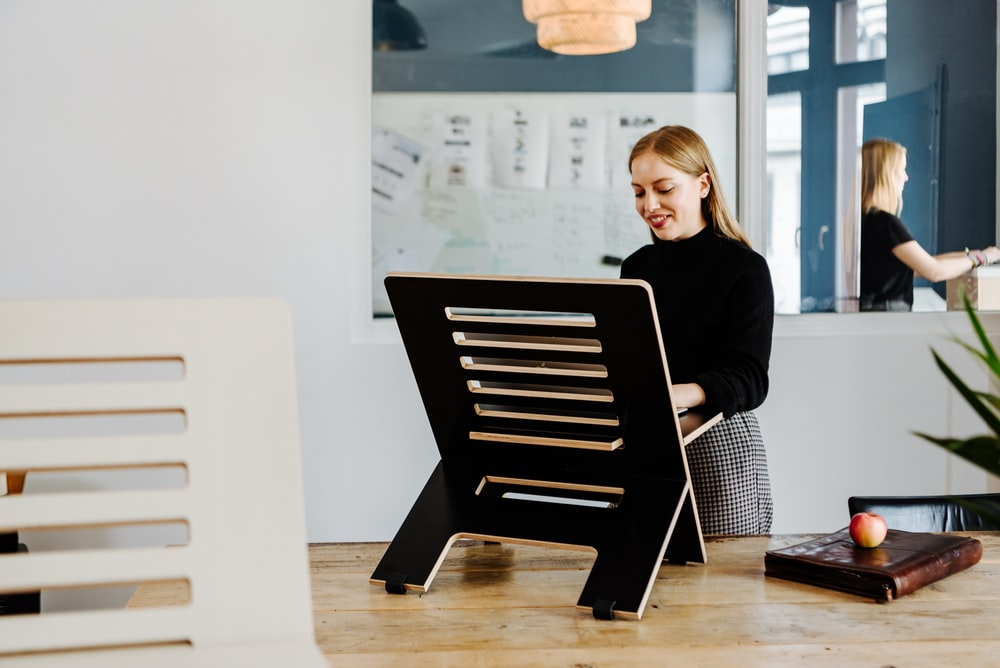 woman in black long sleeve shirt sitting on black chair