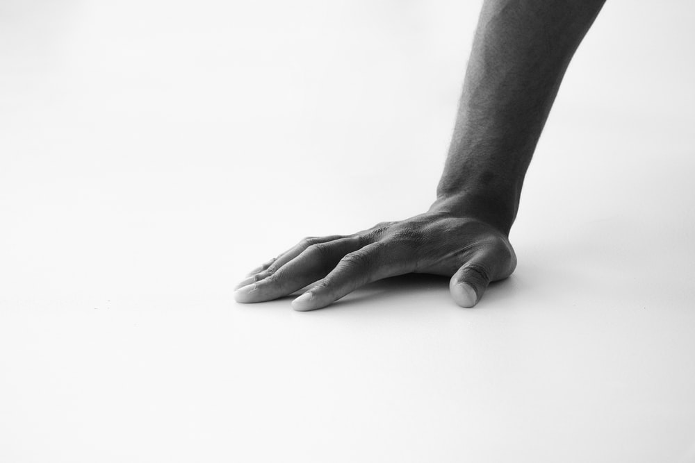 grayscale photo of persons hand