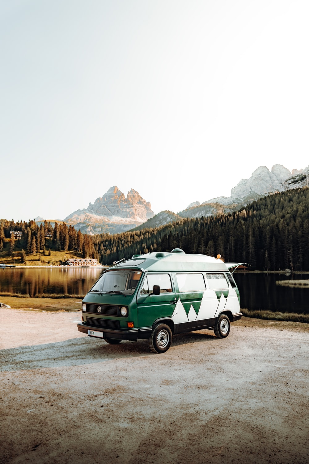 green and white van on road near mountain during daytime