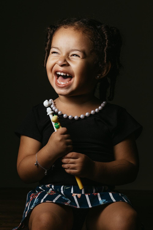 girl in black crew neck t-shirt smiling