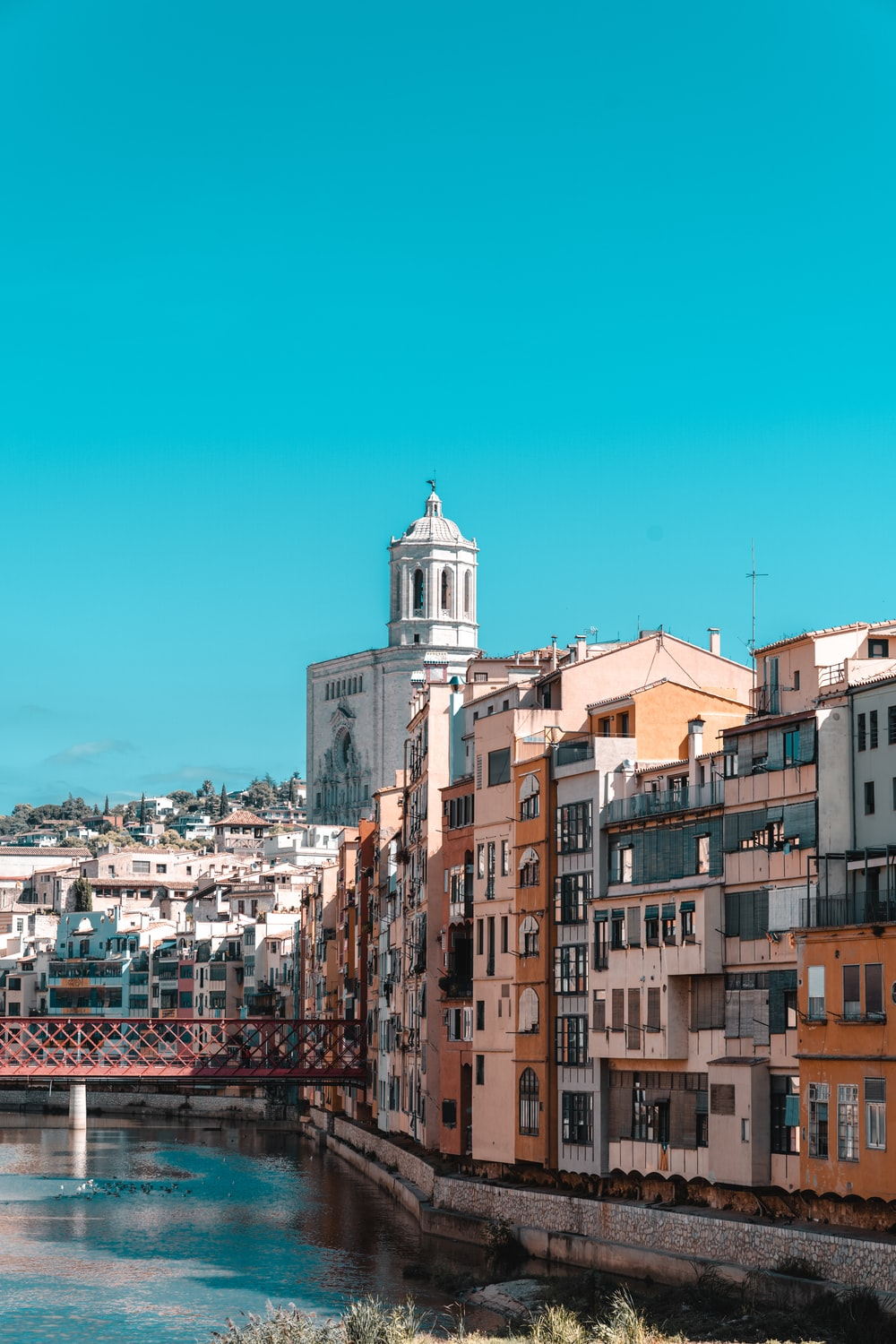 brown and white concrete buildings under blue sky during daytime