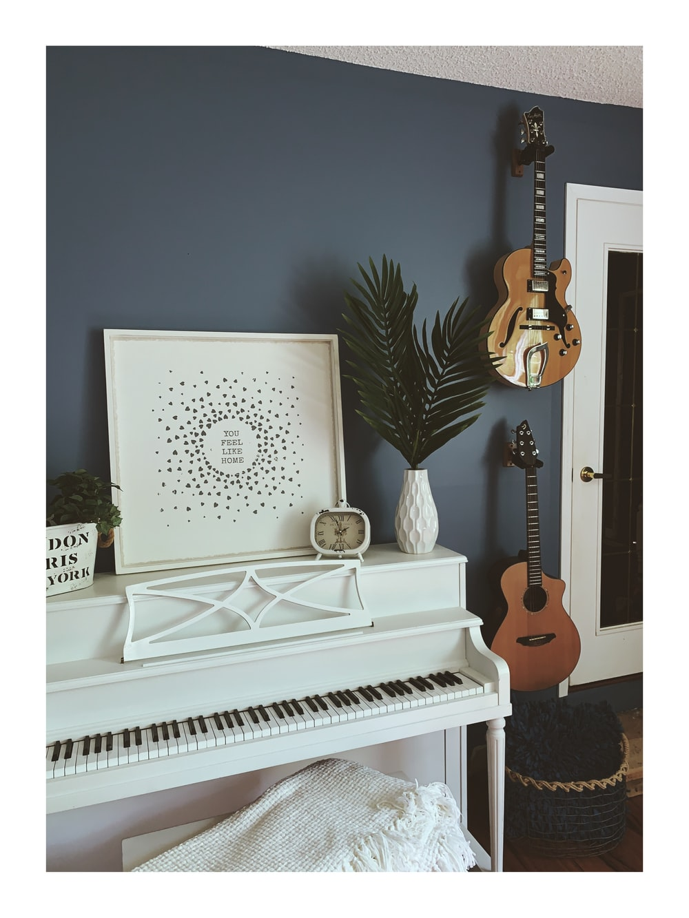 white and brown upright piano