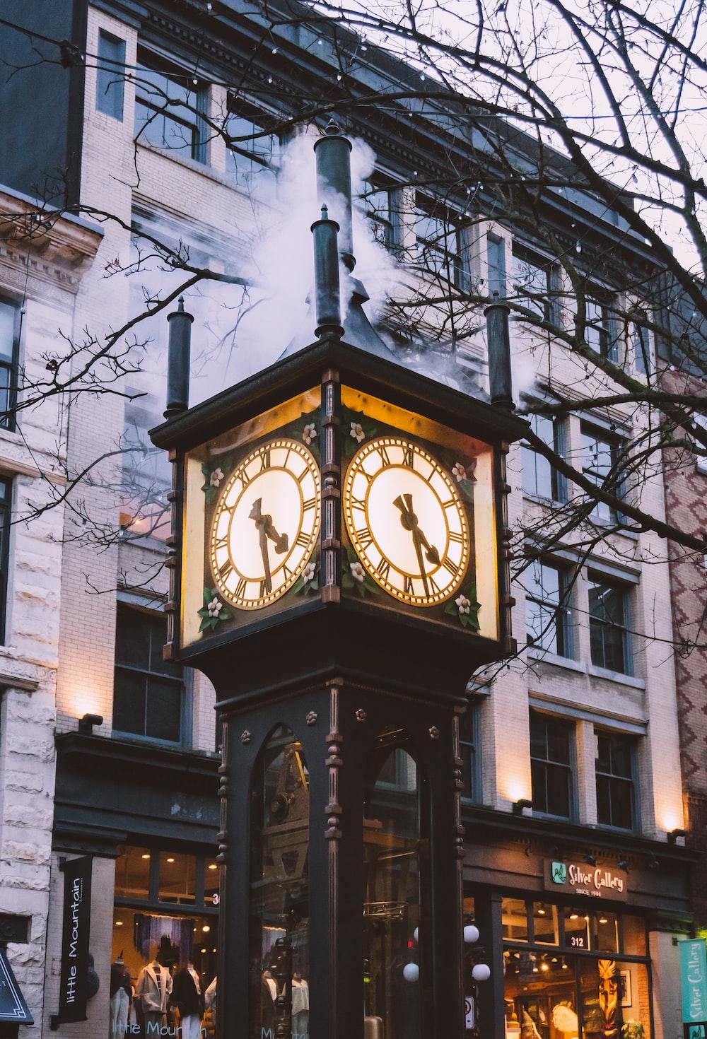 brown wooden analog clock at 10 00