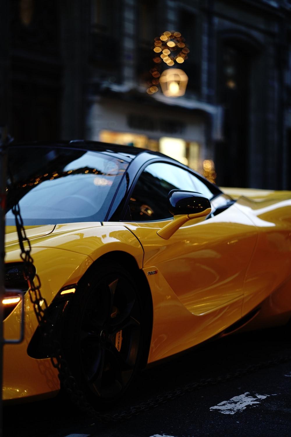 yellow ferrari 458 italia parked on street during daytime