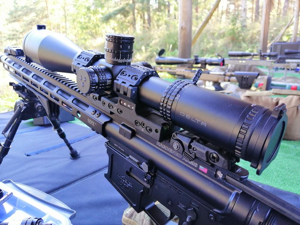black rifle on blue table