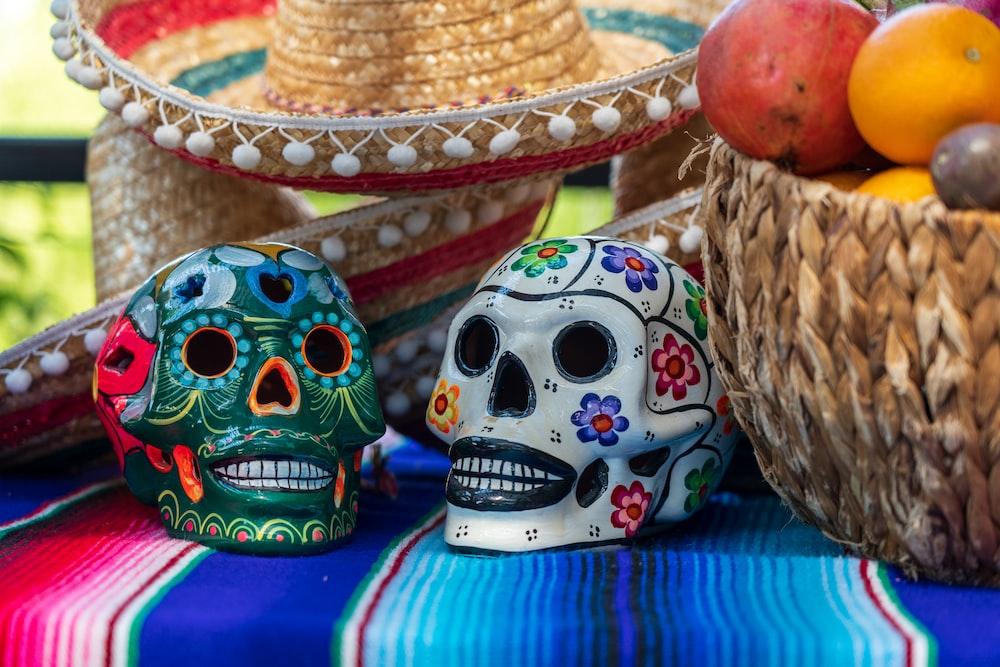 white and red ceramic skull figurine