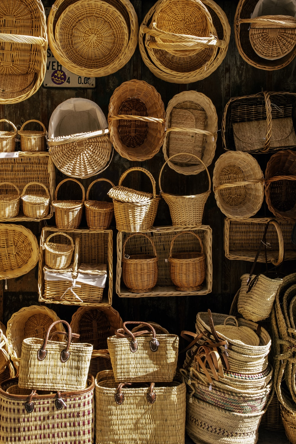 brown woven baskets on white table