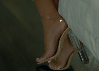 person wearing pink leather peep toe heeled sandals
