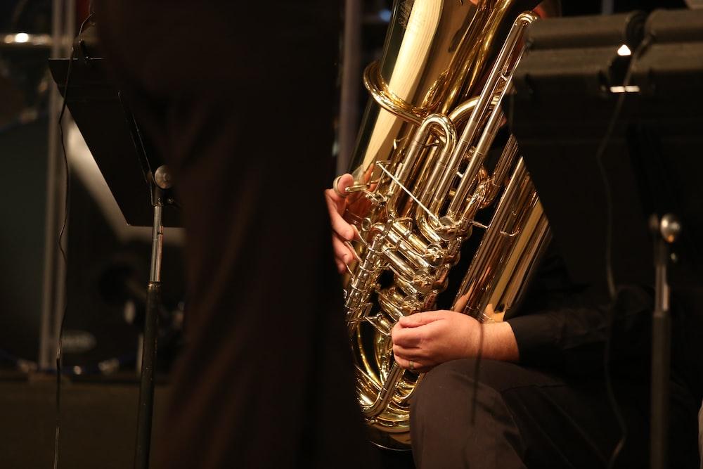 gold trumpet on black textile