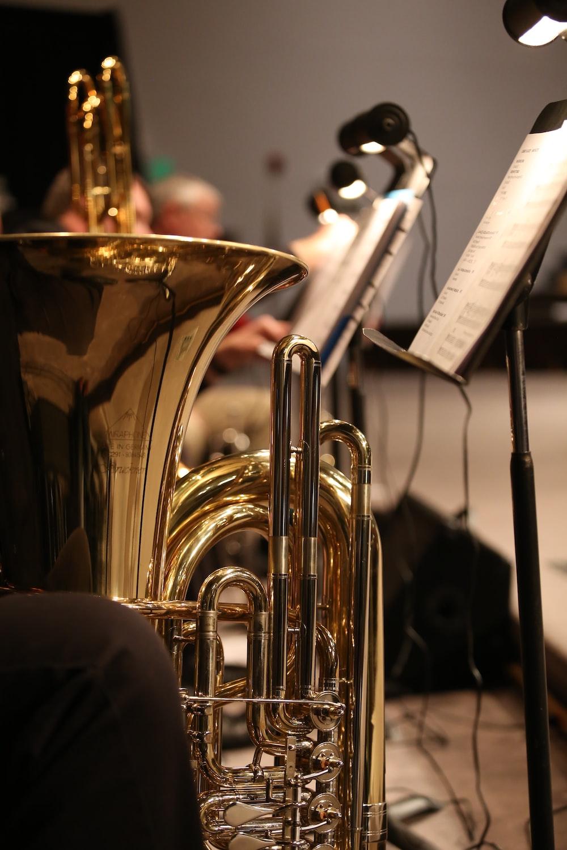 brass trumpet near white printer paper