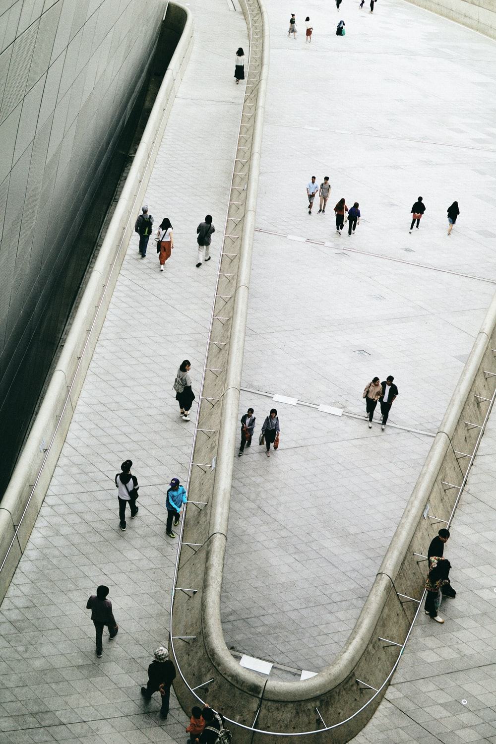 people walking on ice field during daytime