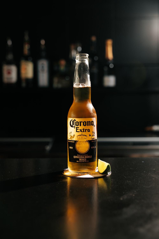 corona extra beer bottle on black table