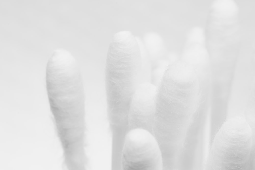 persons hand on white textile