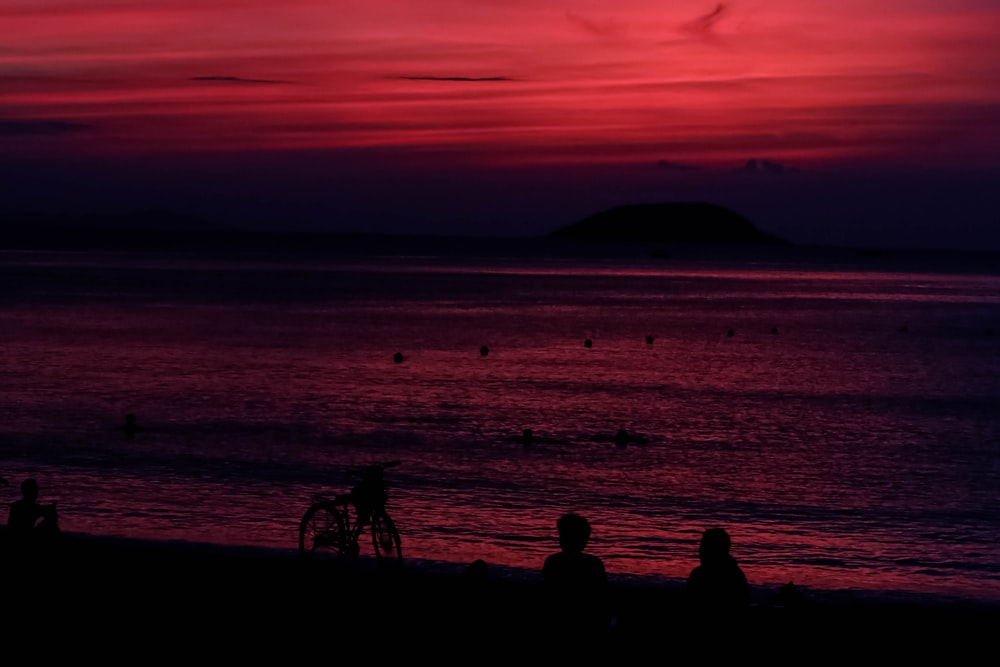 silhouette of people on beach during sunset