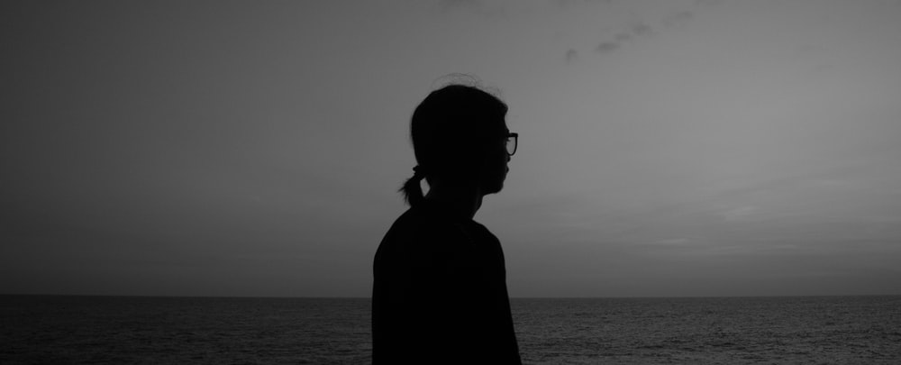silhouette of a person wearing sunglasses